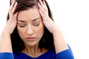 image of woman with a headache or feeling overwhelmed